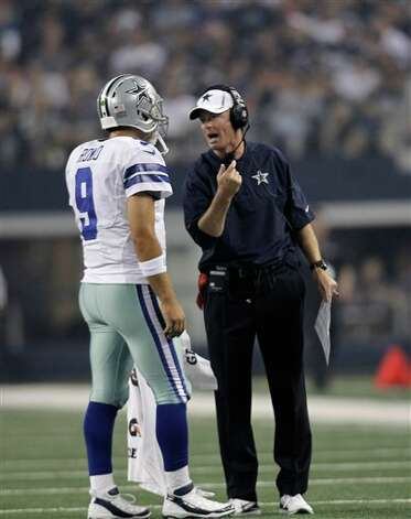 Dallas Cowboys quarterback Tony Romo (9) and head coach Jason Garrett during a preseason NFL football game Saturday, Aug. 25, 2012, in Arlington, Texas. (AP Photo/LM Otero) Photo: LM Otero, Associated Press / AP