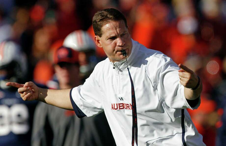 Auburn head coach Gene Chizik runs his team through pre-game drills before an NCAA college football game against Alabama at Jordan-Hare Stadium in Auburn, Ala., Saturday, Nov. 26, 2011. (AP Photo/Dave Martin) Photo: Dave Martin / AP