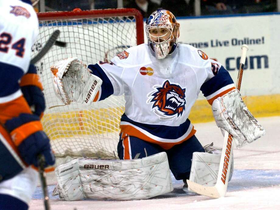 Sound Tigers goalie Rick DiPietro looks to snag an airborne puck, during action against the Springfield Falcons in Bridgeport, Conn. on Saturday Dec. 05, 2009. Photo: Christian Abraham / Connecticut Post