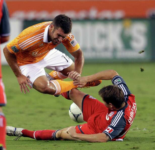 Will Bruin is tripped up by Terry Dunfield of the Toronto FC in the first half.