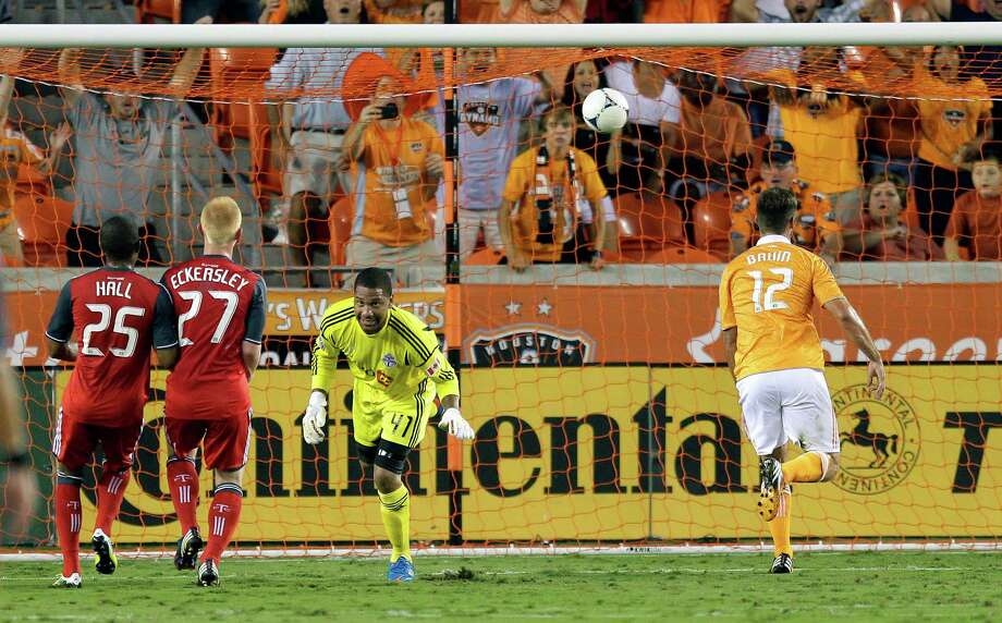 Will Bruin beats goalkeeper Freddy Hall  for a goal in the first half. Photo: Bob Levey, Getty Images / 2012 Getty Images
