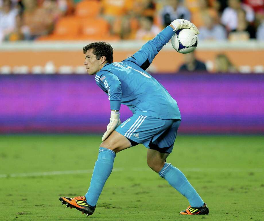 Tally Hall distributes the ball after making a save against the Toronto FC in the first half. Photo: Bob Levey, Getty Images / 2012 Getty Images