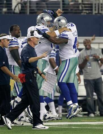 Dallas Cowboys quarterback Tony Romo (9) and running back Lawrence Vickers (47) celebrate a touchdown as head coach Jason Garrett looks on during a preseason NFL football game Saturday, Aug. 25, 2012, in Arlington, Texas. (AP Photo/LM Otero) Photo: LM Otero, Associated Press / AP