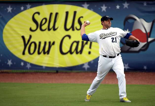 Sugar Land Skeeters pitcher Roger Clemens warms up before a baseball game against the Bridgeport Bluefish Saturday, Aug. 25, 2012, in Sugar Land, Texas. Clemens, a seven-time Cy Young Award winner, signed with the Skeeters of the independent Atlantic League, this week. Photo: David J. Phillip