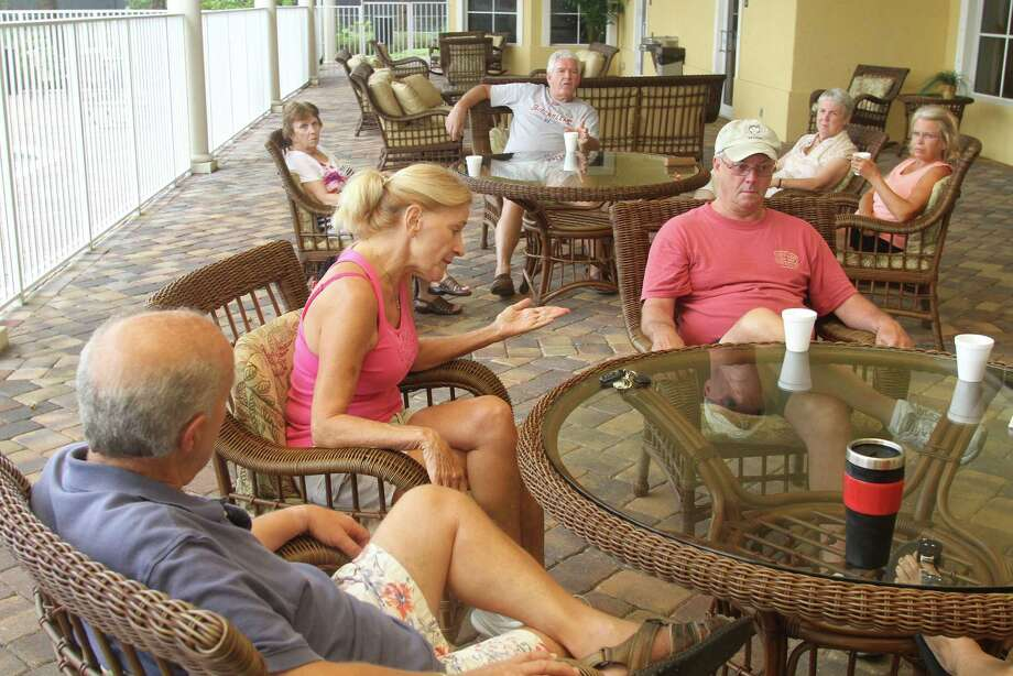 Residents of the Woodfield retirement community clubhouse in Vero Beach, Fla., find themselves divided or undecided over the nation's choice for president in the upcoming November election. Photo: Keith Carson / San Francisco Chronicle