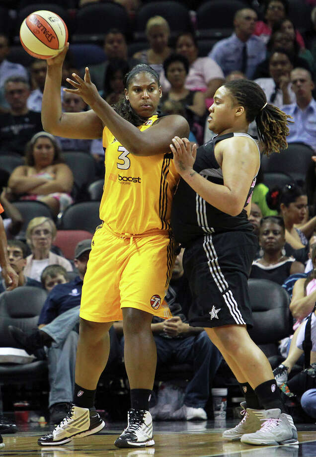 Shock center Courtney Paris is guarded by Danielle Adams a the Silver Stars host the Tulsa Shock at the AT&T Center on August 25, 2012. Photo: Tom Reel, Express-News / ©2012 San Antono Express-News