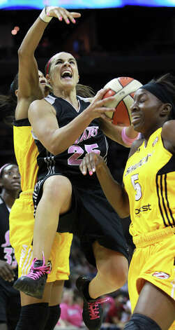 Becky Hammon twists through defense in the second half a the Silver Stars host the Tulsa Shock at the AT&T Center on August 25, 2012. Photo: Tom Reel, Express-News / ©2012 San Antono Express-News