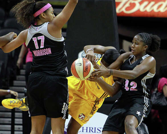 Ziomara Morrison and Shenise Johnson play tough defense in the lane as the Silver Stars host the Tulsa Shock at the AT&T Center on August 25, 2012. Photo: Tom Reel, Express-News / ©2012 San Antono Express-News