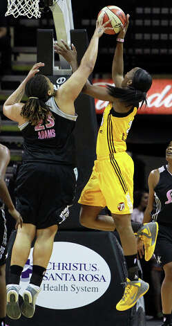 Danielle Adams gets a block on Glory Johnson as the Silver Stars host the Tulsa Shock at the AT&T Center on August 25, 2012. Photo: Tom Reel, Express-News / ©2012 San Antono Express-News