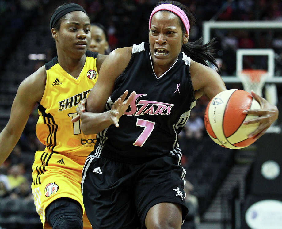 Jia Perkins gets into the lane against Ivory Latta as the Silver Stars host the Tulsa Shock at the AT&T Center on August 25, 2012. Photo: Tom Reel, Express-News / ©2012 San Antono Express-News