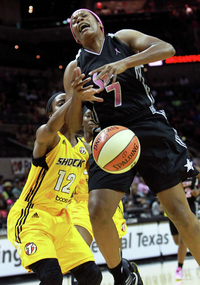 Jia Perkins is fouled going up by Ivory Latta as the Silver Stars host the Tulsa Shock at the AT&T Center on August 25, 2012. Photo: Tom Reel, Express-News / ©2012 San Antono Express-News