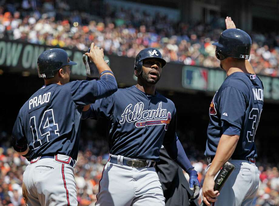 Jason Heyward, right, helps the Braves end the Giants' five-game win streak with a three-run homer in the third inning. Photo: Eric Risberg / AP