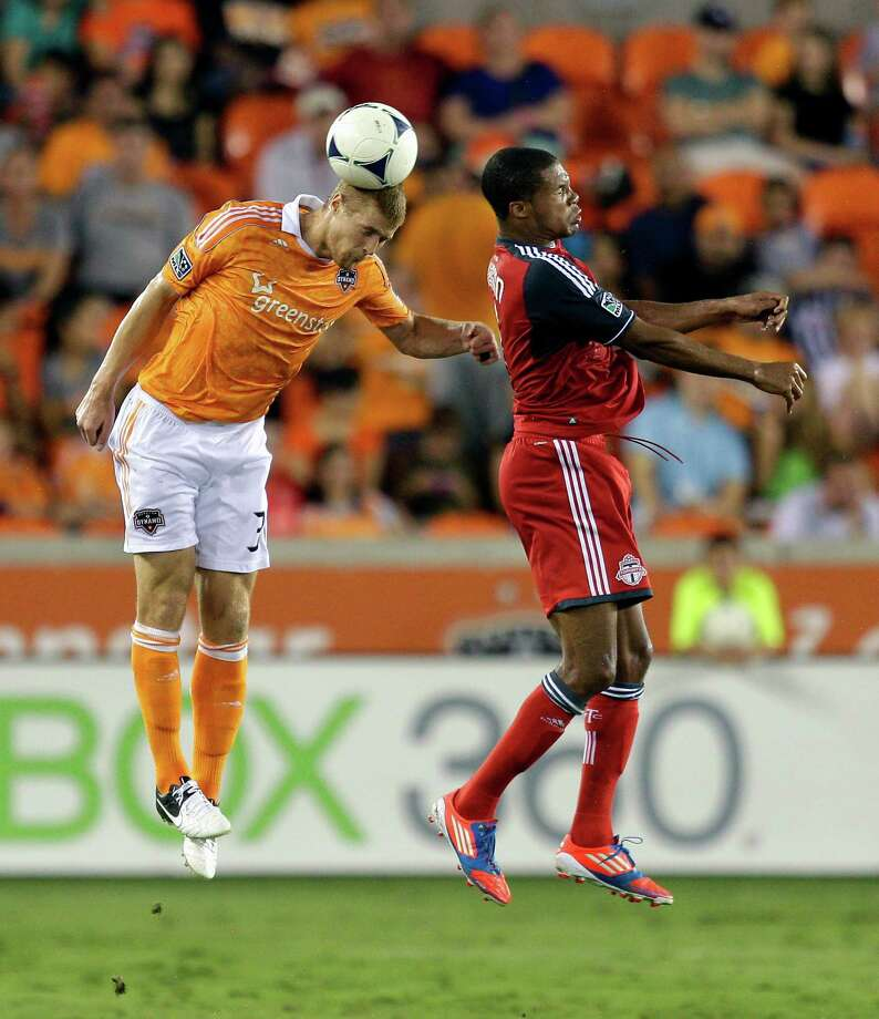 Andre Hainault heads the ball away from Ryan Johnson in the second half. Photo: Bob Levey, Getty Images / 2012 Getty Images