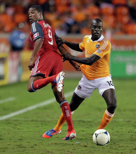 Ryan Johnson of the Toronto FC backheals the ball away from Je-Vaughn Watson in the second half.