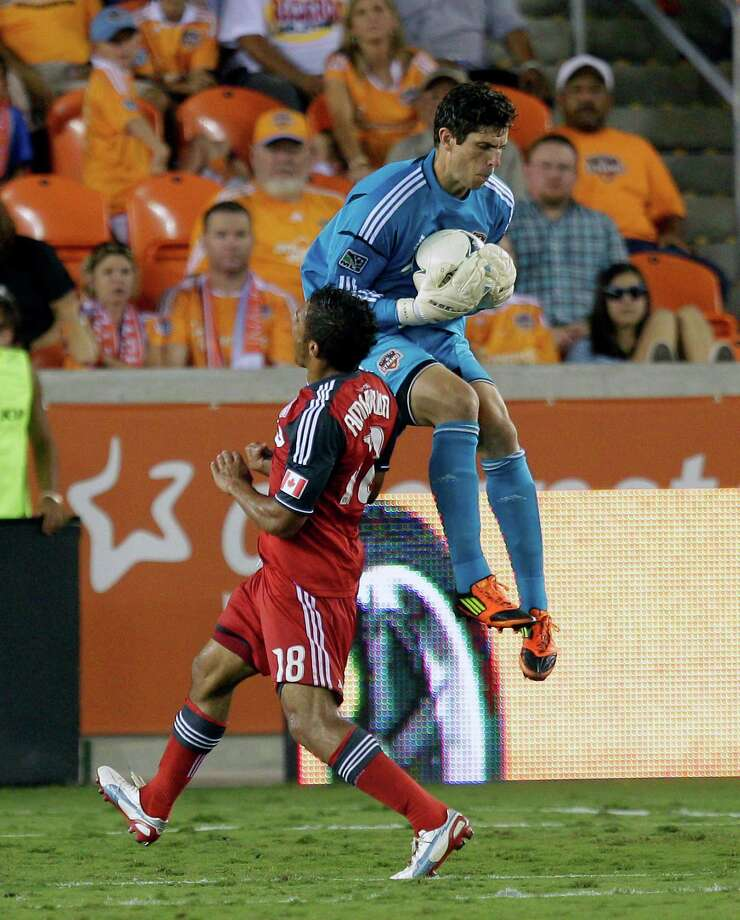 Goalkeeper Tally Hall gets to the ball before Quincy Amarikwa of Toronto FC in the second half. Photo: Bob Levey, Getty Images / 2012 Getty Images