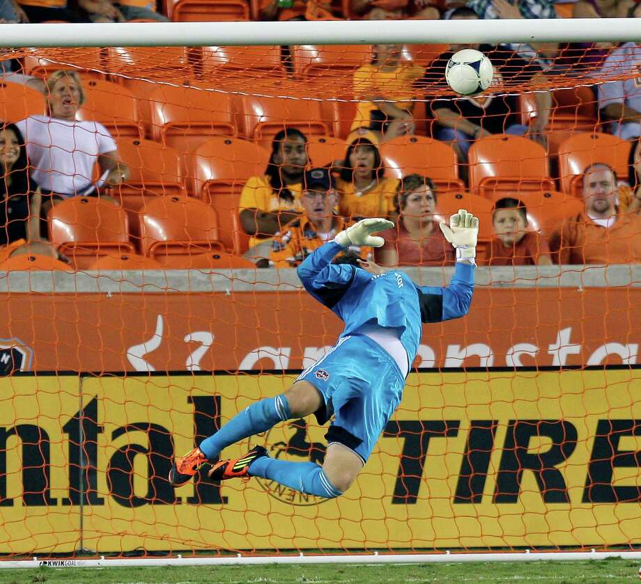 Tally Hall can't make a save off a header by Terry Dunfield of Toronto FC in the second half. Photo: Bob Levey, Getty Images / 2012 Getty Images