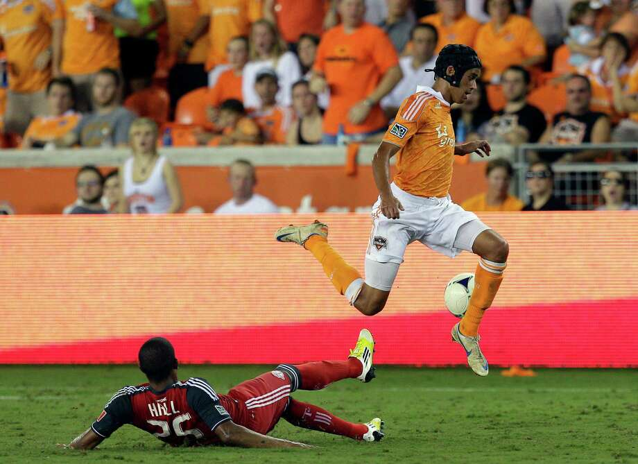 Calen Carr leaps over a sliding Jeremy Hall in the second half. Photo: Bob Levey, Getty Images / 2012 Getty Images