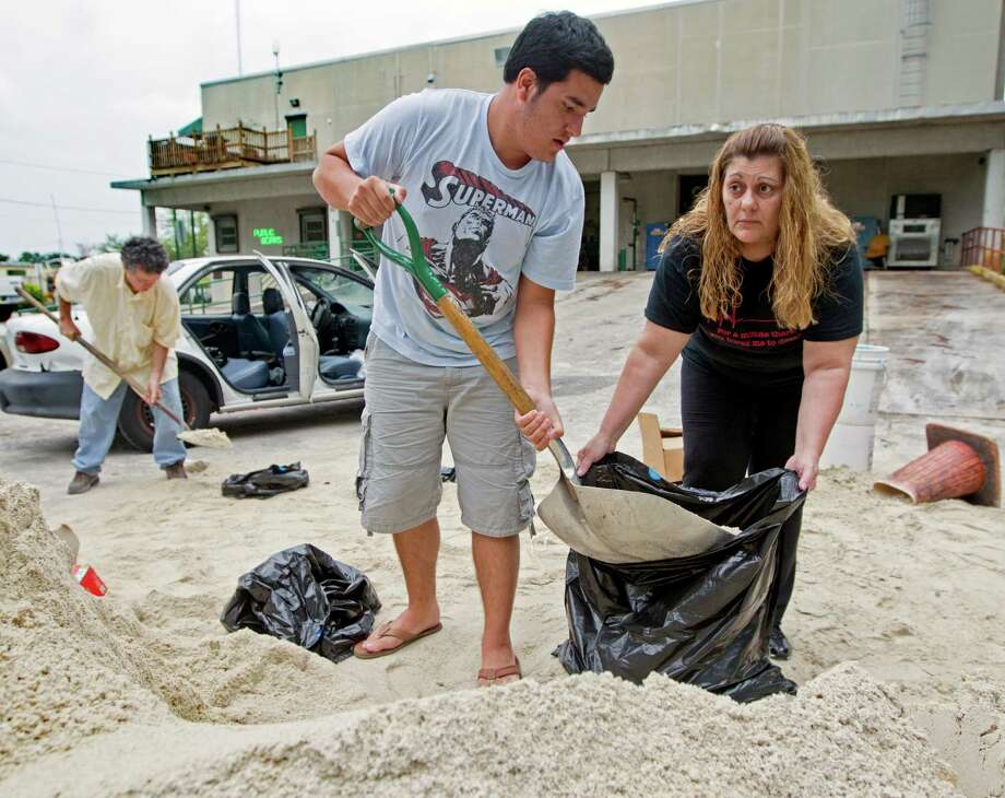 Connie Rivero and her son Anthony Amador fill plastic bags with sand Saturday at the Hollywood, Fla., Public Works Department as they prepare for possible floods from Tropical Storm Isaac. Photo: Al Diaz / The Miami Herald