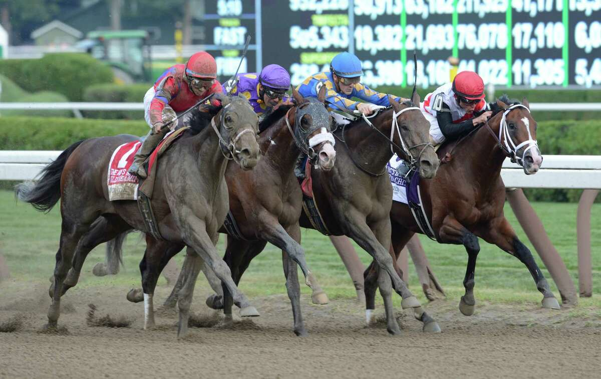#1 Willy Beamin with jockey Alan Garcia comes back on only a few days rest after a win previously this week to win the 28th running of the Foxwood's King's Bishop at the Saratoga Race Course in Saratoga Springs, N.Y. Aug. 25, 2012. (Skip Dickstein/Times Union)