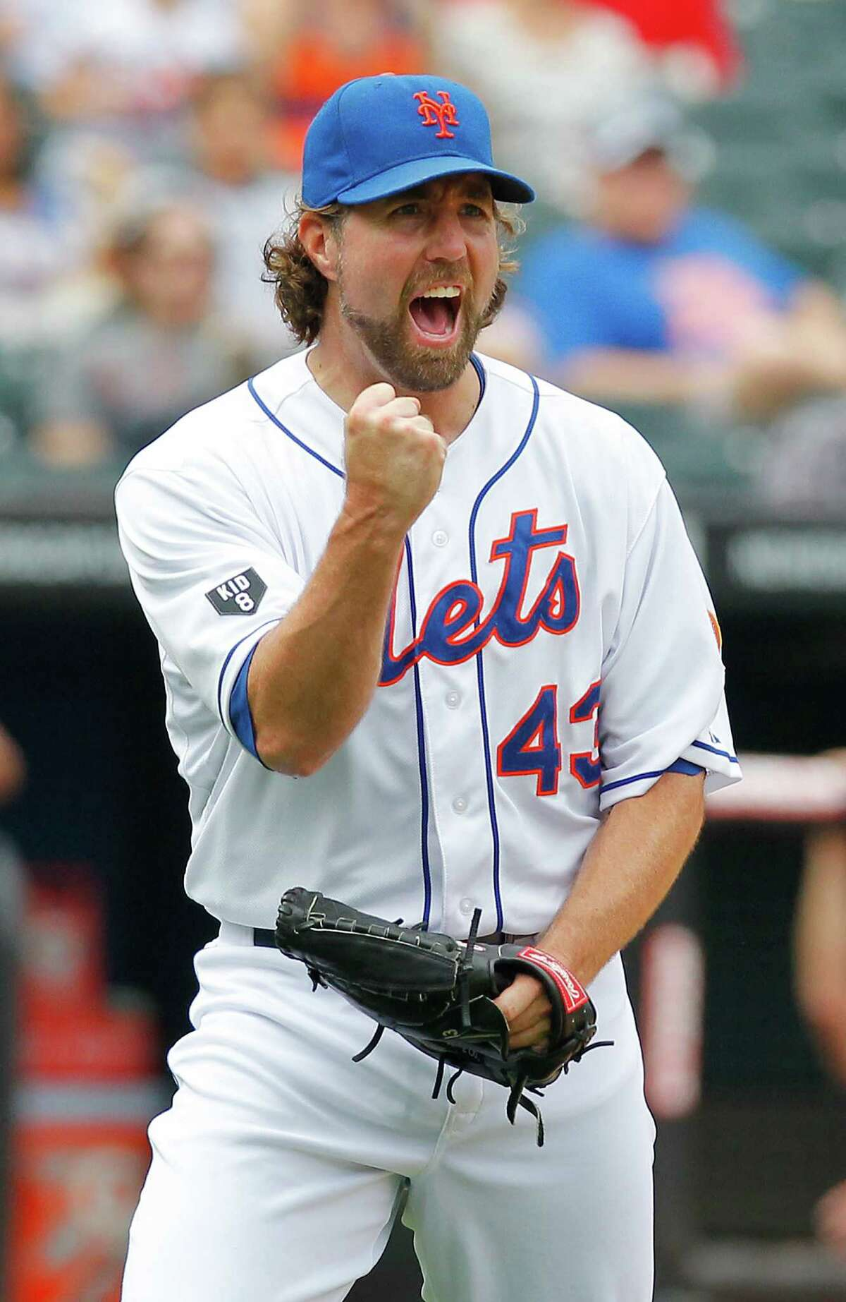 New York Mets pitcher R.A. Dickey reacts to a double play which ended the top of the fifth inning of a baseball game against the Houston Astros in New York, Saturday, Aug. 25, 2012. (AP Photo/Paul J. Bereswill)
