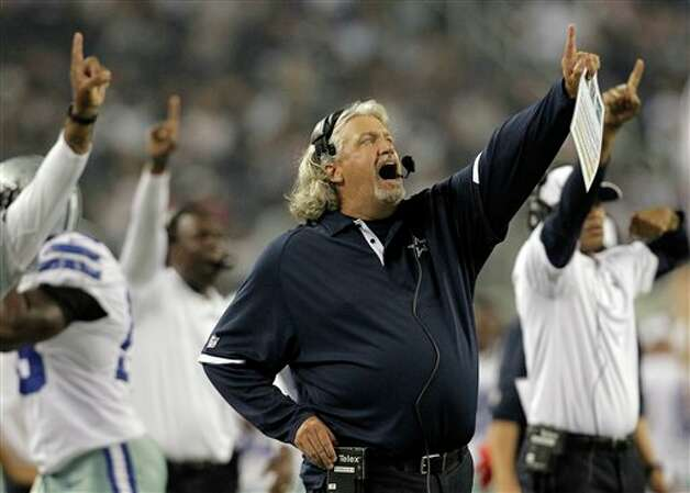 Dallas Cowboys defensive coordinator Rob Ryan and others point to the big screen against the St. Louis Rams during the second half of a preseason NFL football game, Saturday, Aug. 25, 2012 in Arlington, Texas. (AP Photo/Brandon Wade) Photo: Brandon Wade, Associated Press / FR168019 AP