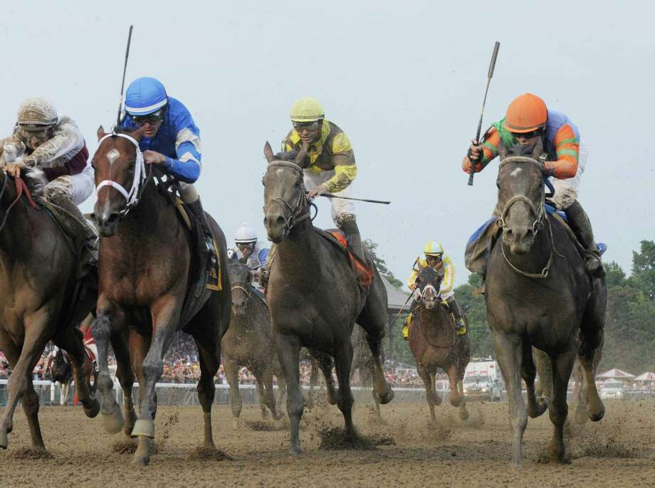 Alpha with jockey Ramon Dominguez, second from left dead heats with Golden Ticket with jockey David Cohen, right for the win in the 143rd running of The Travers Stakes  at the Saratoga Race Course  in Saratoga Springs, N.Y. Aug. 25, 2012.   (Skip Dickstein/Times Union) Photo: Skip Dickstein