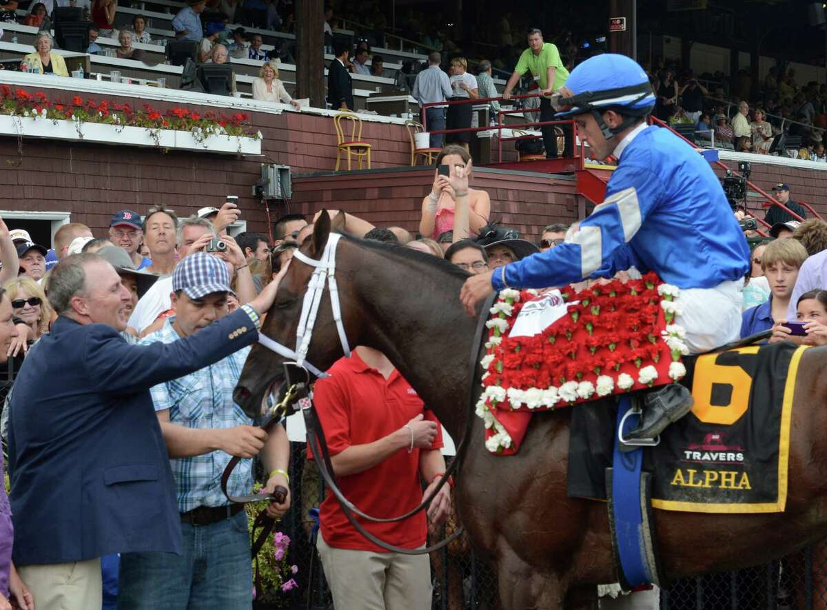 Alpha with jockey Ramon Dominguez after the dead heat win in the 143rd running of The Travers Stakes at the Saratoga Race Course in Saratoga Springs, N.Y. Aug. 25, 2012. (Skip Dickstein/Times Union)