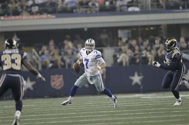 Dallas Cowboys quarterback Stephen McGee (7) looks for an open receiver as St. Louis Rams defensive back Quinton Pointer (33) and teammate defensive end William Hayes (95) defend during the second half of a preseason NFL football game, Saturday, Aug. 25, 2012 in Arlington, Texas. (AP Photo/Brandon Wade) Photo: Brandon Wade, Associated Press / FR168019 AP