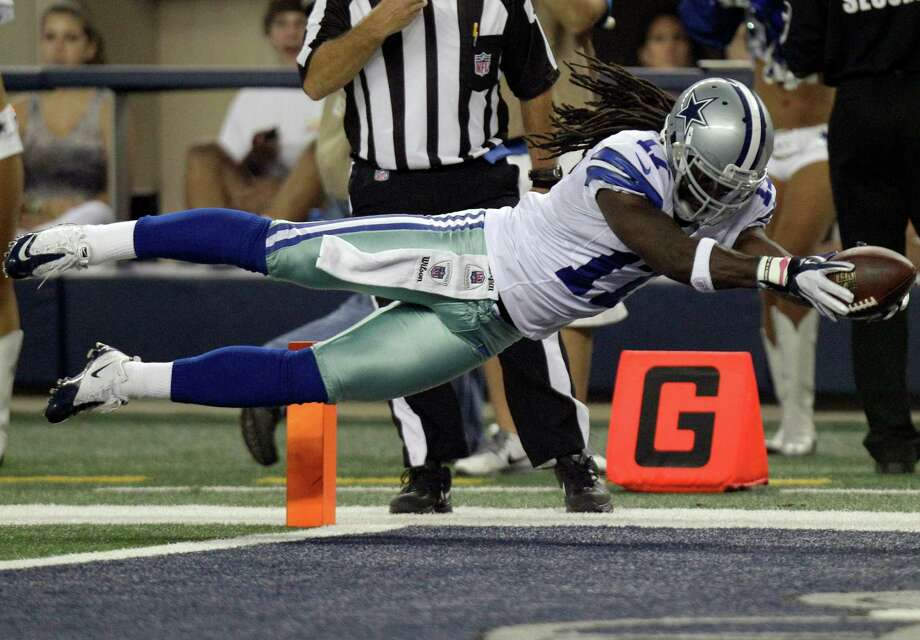 Cowboys wide receiver Dwayne Harris flies into the end zone for one of his two touchdown passes in Saturday night's victory over St. Louis. Photo: LM Otero / AP