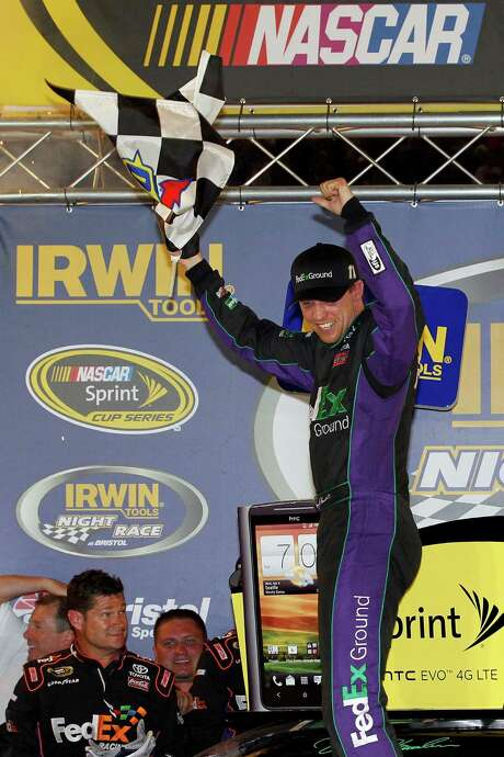 Denny Hamlin, above, celebrates after fending off Carl Edwards to win the Sprint Cup race at Bristol, Tenn., Saturday. Photo: Tyler Barrick / 2012 Getty Images