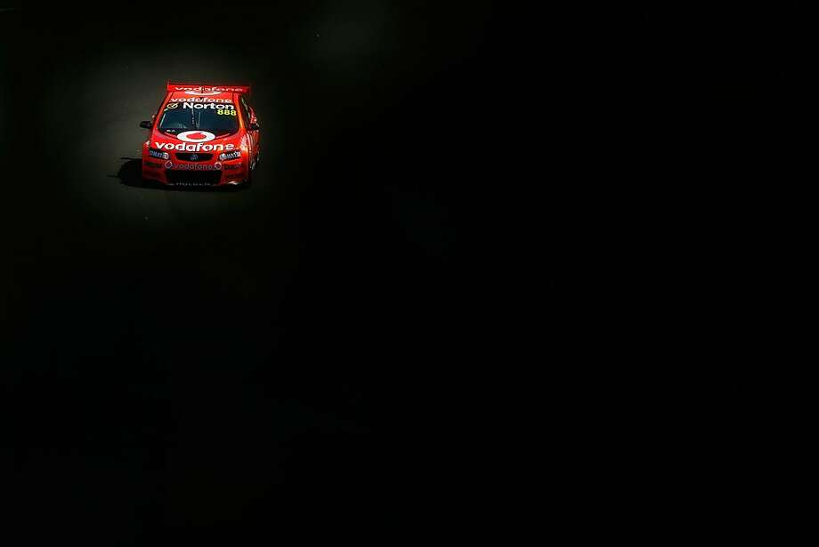 Craig Lowndes driver of the #888 Team Vodafone Holden drives during qualifying for round nine of the V8 Supercars Championship Series at Sydney Motorsport Park on August 26, 2012 in Sydney, Australia. Photo: Brendon Thorne, Getty Images