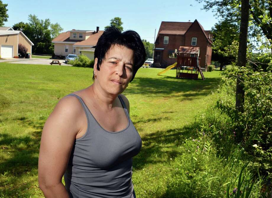 Amy DiModugno, of Halfmoon, said her backyard on Hudson River Road often floods when heavy rains strike. She has been cited by the U.S. Army Corps of Engineers for filling in part of her yard that's federal wetlands. A neighbor also is suing her for doing it. (John Carl D'Annibale / Times Union) Photo: John Carl D'Annibale / 00018111A