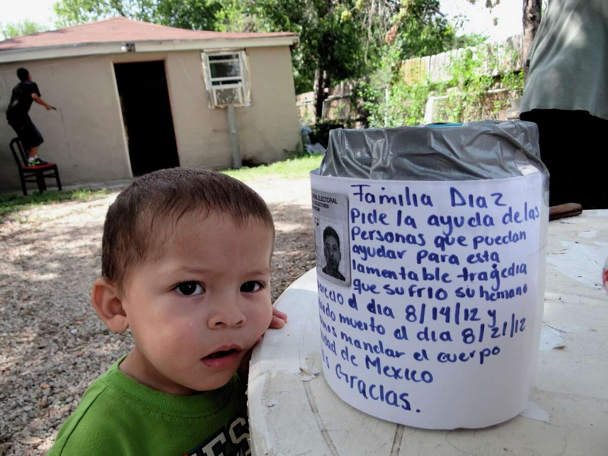 Octavio Diaz, 2, nephew of Inocencio Victor Rodriguez Diaz, a worker who died after falling into a smokestack at the Pearl Brewery, stands by a collection jar during a barbecue plate sale on Saturday, Aug. 26, to help the family raise funds to take his body to Mexico for burial. Donations can be made by calling 210-514-2701.