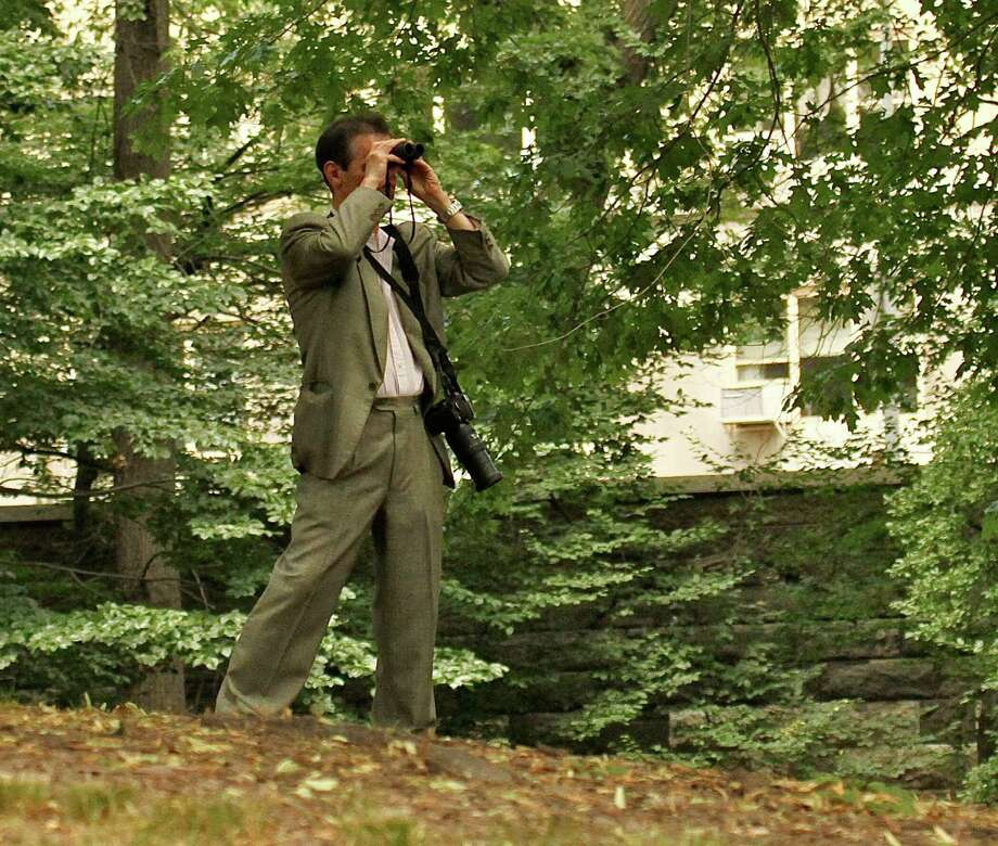 In this June 30, 2012 photo provided by Jean Shum, Jeffrey Johnson uses binoculars to search New York?s Central Park for the young offspring of a popular red-tailed Hawk that local birdwatchers know as Pale Male. On Friday, Aug. 24, 2012, Johnson killed a former employer outside the Empire State Building in New York and was himself killed shortly afterwards by police. Nine bystanders were wounded in that chaotic confrontation. (AP Photo/Jean M. Shum) MANDATORY CREDIT Photo: Jean M. Shum / Jean M. Shum