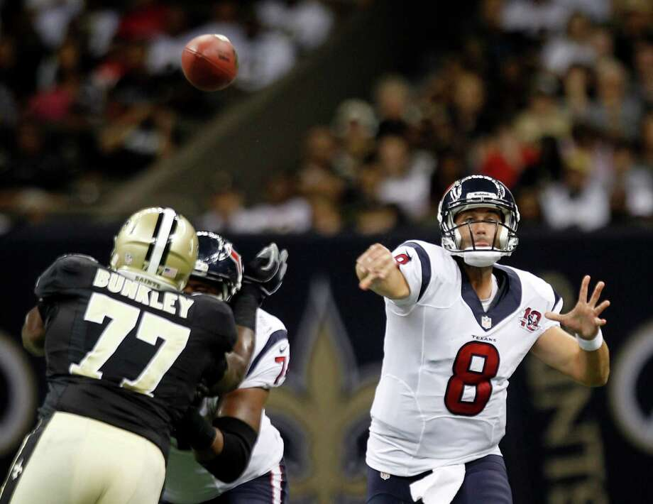 Quarterback Matt Schaub, right, was one of the few bright spots in the Texans' loss to the Saints. Photo: Brett Coomer / © 2012  Houston Chronicle