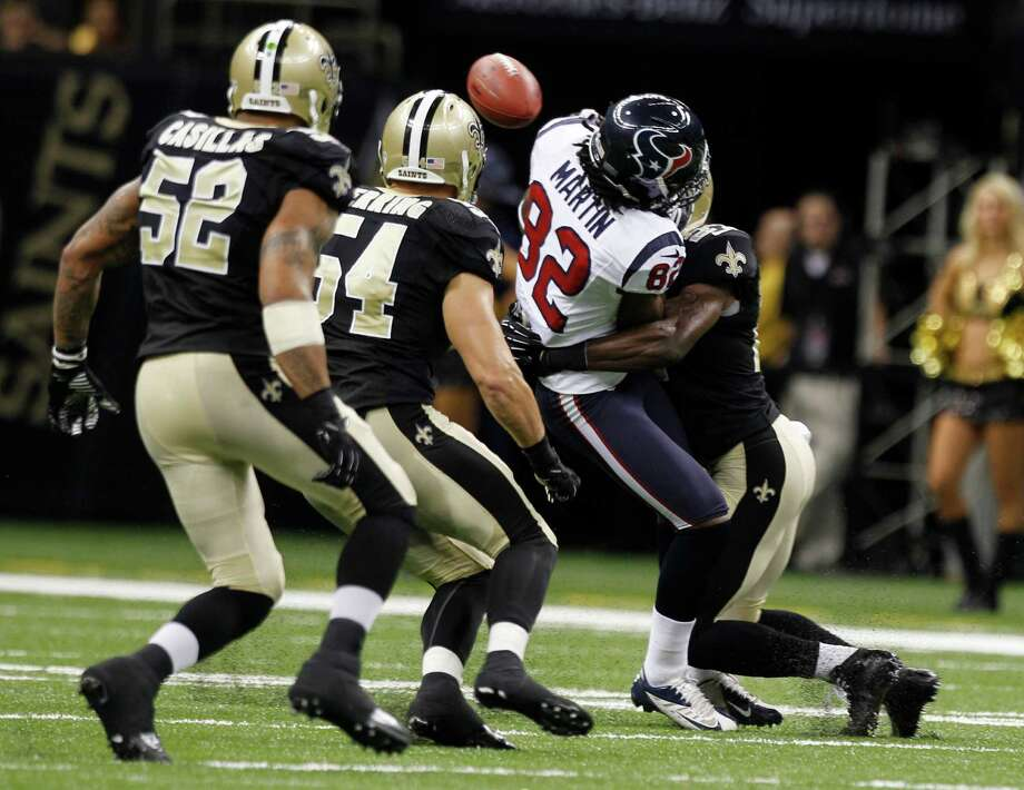 Keshawn Martin found out how hard the hits are when playing an NFL team like the New Orleans Saints, fumbling twice in the third preseason game of his career. Photo: Brett Coomer / © 2012  Houston Chronicle