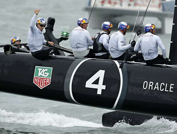 Skipper James Spithill (left) waves to the crowd after Oracle Team USA Spithill won at the America's Cup World Series in August. Photo: Beck Diefenbach, Special To The Chronicle