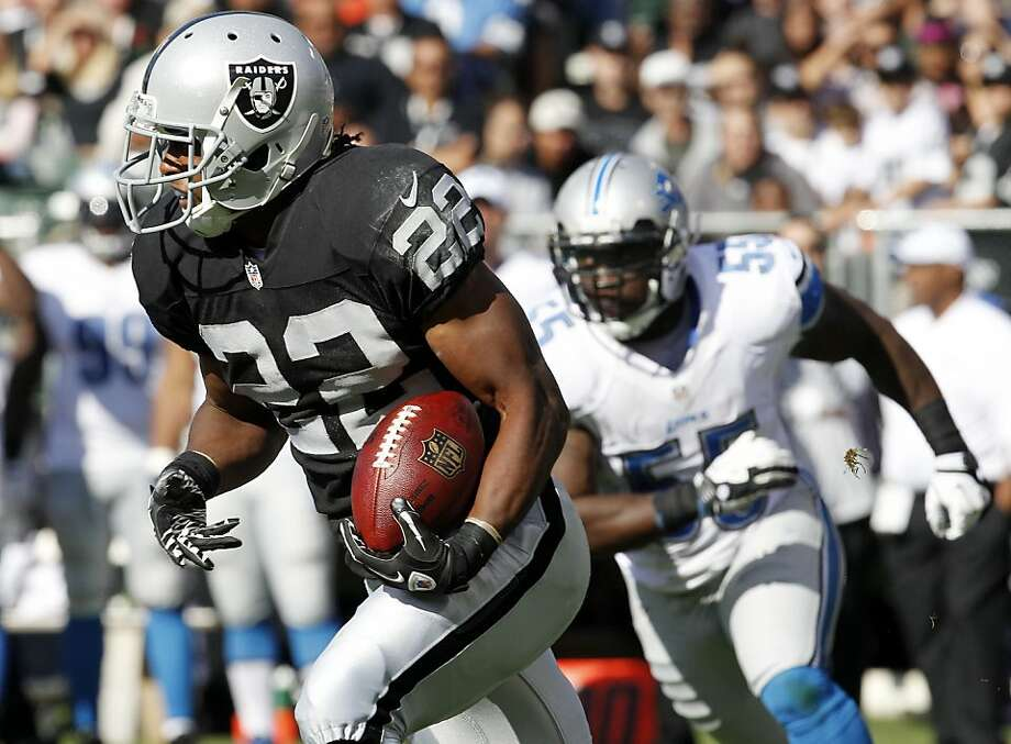 Oakland Raiders running back Taiwan Jones (22) in action against the Detroit Lions during a preseason NFL football game in Oakland, Calif., Saturday, Aug. 25, 2012. (AP Photo/Tony Avelar) Photo: Tony Avelar, Associated Press