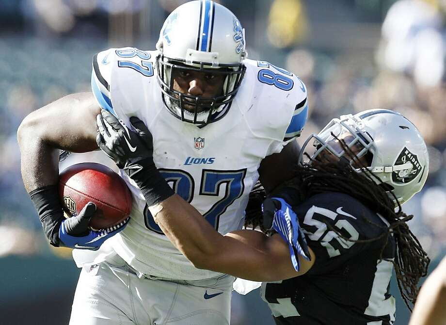 Detroit Lions tight end Brandon Pettigrew (87), is defended by Oakland Raiders linebacker Philip Wheeler (52) during a preseason NFL football game in Oakland, Calif., Saturday, Aug. 25, 2012. (AP Photo/Tony Avelar) Photo: Tony Avelar, Associated Press