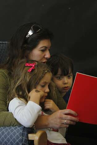 Substitute teacher Sandra Lampear reads a story to Maia Rinaudo (left) and Miles Bernson in a transitional kindergarten class in San Francisco. Photo: Lea Suzuki, The Chronicle / SF