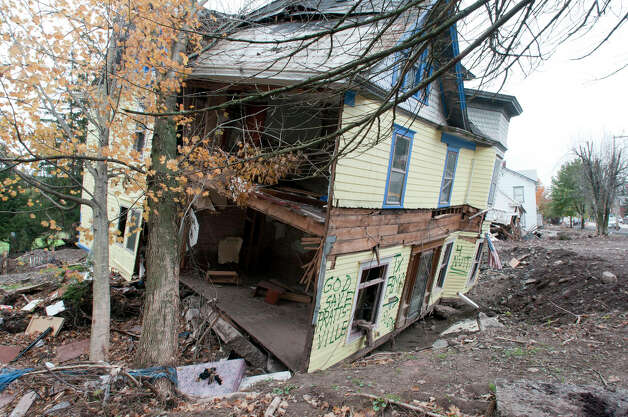 A view of a condemned home at 14602 Main St. in Prattsville on Thursday, Oct. 13, 2011. Many of the homes in the town were badly damaged by Tropical Storm Irene and the flooding it brought.  (Paul Buckowski / Times Union) Photo: Paul Buckowski / 00014963A