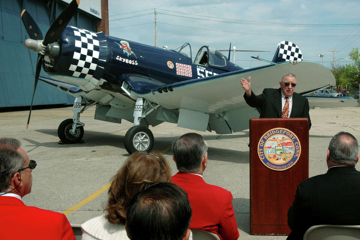 """State Sen. George """"Doc"""" Gunther speaks in front of a Vought F4U Corsair at Sikorsky Memorial Airport in Stratford, Conn. May 18th, 2005. Built in Stratford, Gunther fought to have the Corsair named the State of Connecticut's official state aircraft."""