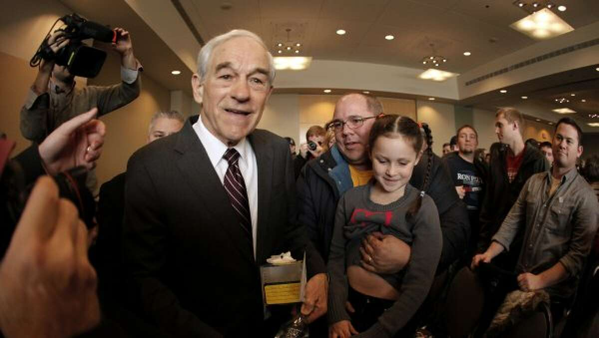 Ron Paul greets the crowd during a campaign stop in Dubuque, Iowa, Thursday, Dec. 22, 2011. (Charlie Riedel / The Associated Press)