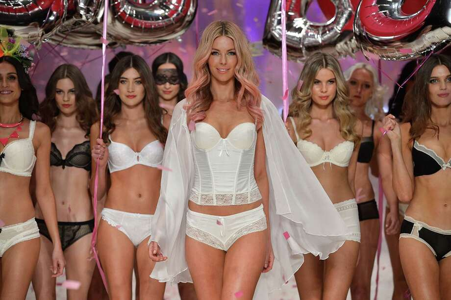Jennifer Hawkins (center) and models showcase designs by Bendon on the catwalk. Photo: Stefan Gosatti, Getty Images / 2012 Getty Images