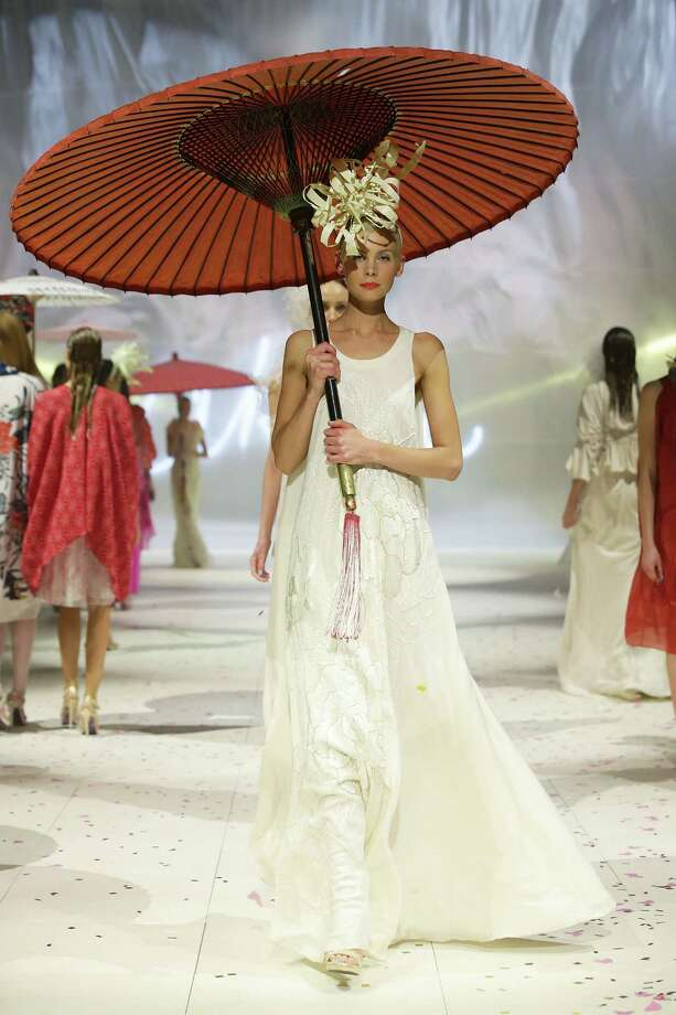 A model showcases designs by Akira on the catwalk. Photo: Matt King, Getty Images / 2012 Getty Images
