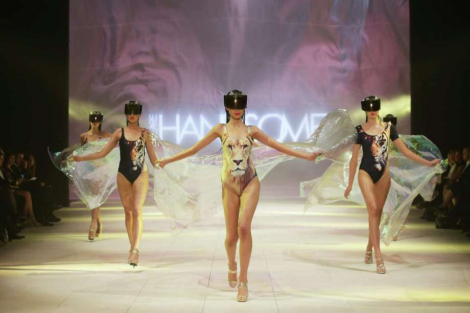 Models showcase designs by We Are Handsome on the catwalk. Photo: Matt King, Getty Images / 2012 Getty Images
