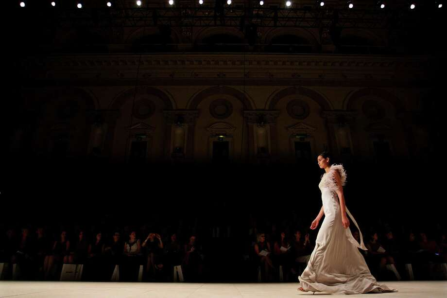 A model  showcases designs by Aurelio Costarella during the MYER Collection show. Photo: Lisa Maree Williams, Getty Images / 2012 Getty Images