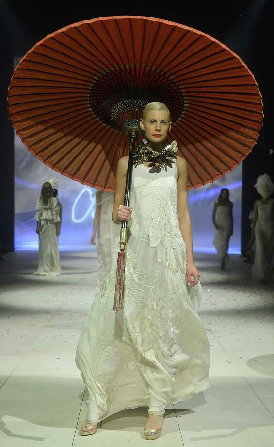 A model showcases designs by Akira on the catwalk. Photo: Stefan Gosatti, Getty Images / 2012 Getty Images