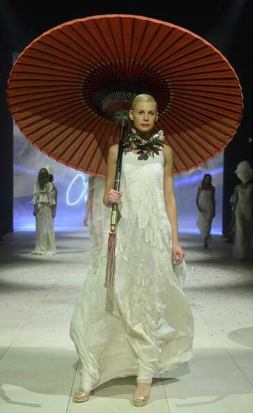 A model showcases designs by Akira on the catwalk.