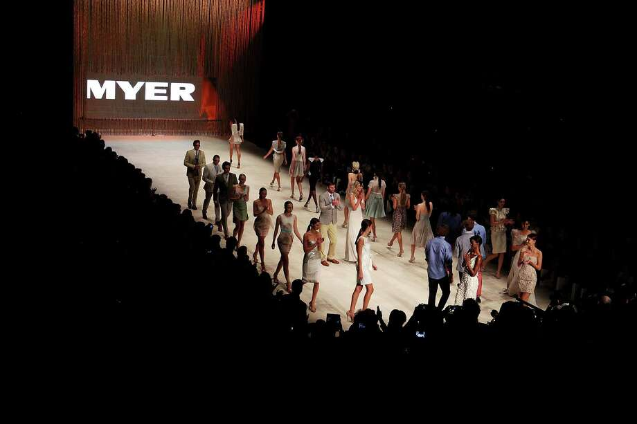 Kris Smith and Jennifer Hawkins showcase designs during the finale of the MYER Collection show. Photo: Don Arnold, Getty Images / 2012 Getty Images